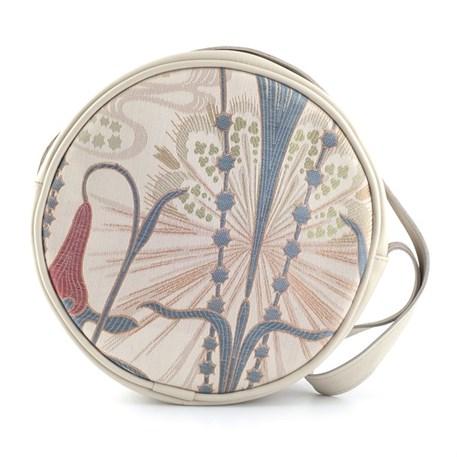 Ronde handtas van elegante art nouveau stof, gecombineerd met crèmekleurig leder.
